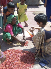 Deepa with a woman entrepreneur on our visit to Dharavi, 2007
